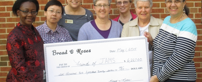 Friends of JAMS receives check from Bread & Roses
